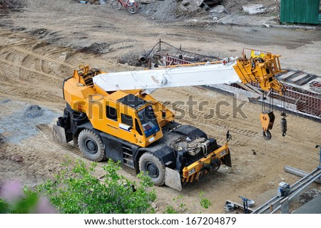 Mobile crane at the construction site. - stock photo