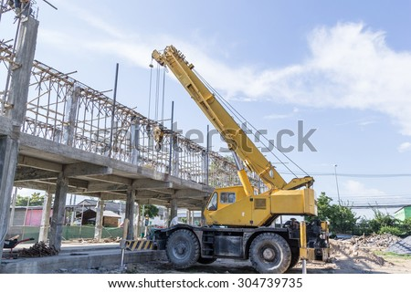 Mobile crane on Construction site - stock photo