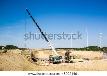 Mobile Crane.Sustainable Construction.Construction Crane.Forklift Crane.Forklift.Construction Highways.Construction Road.Construction Industry.Construction.Begun.Transporting Heavy Loads.Heavy Thing. - stock photo