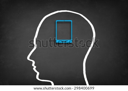 Mobile device in head. Modern technology concept. - stock photo