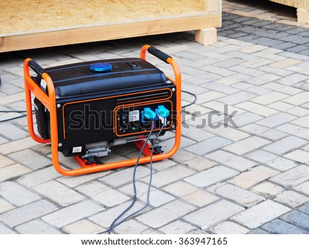 Mobile Gasoline Generator on the Building Site  - stock photo