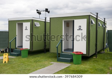 mobile gents toilets used at an event or festival  - stock photo