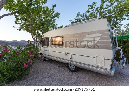 Mobile home on a camping site in Spain - stock photo