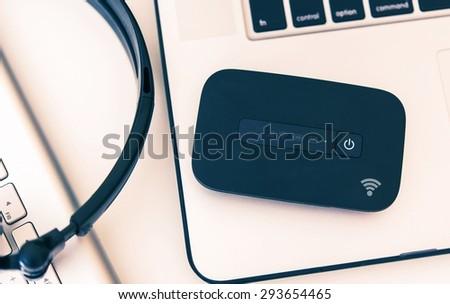 Mobile Hotspot Wi-Fi Device and Laptop Workstation. Cellular Broadband Technology. Internet On The Go. - stock photo