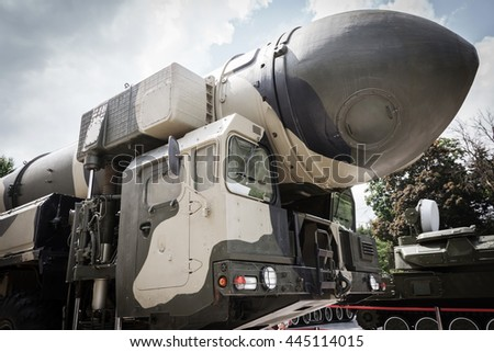 mobile intercontinental ballistic missiles on background sky - stock photo