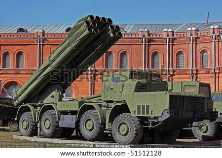 mobile missile system near the old red building - stock photo