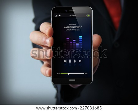 mobile music concept: audio app on touchscreen smartphone - stock photo