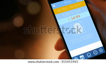 Mobile Payment,  smart pay - man holding a phone with contactless pay wallet app for smart shopping