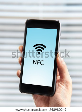 Mobile payment using a cellphone equipped with NFC - stock photo