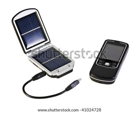 mobile phone and charging the device operates with solar panels - stock photo