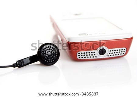 Mobile phone and headphones isolated on white - stock photo