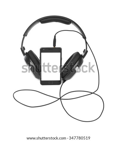 Mobile phone and headphones isolated on white background - stock photo
