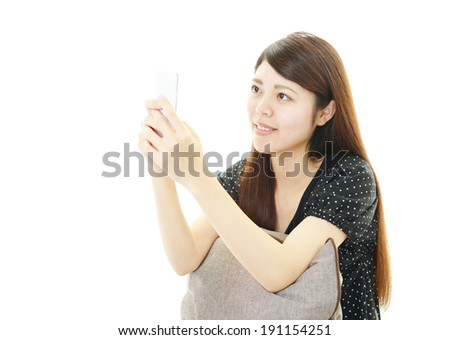 Mobile phone and woman.