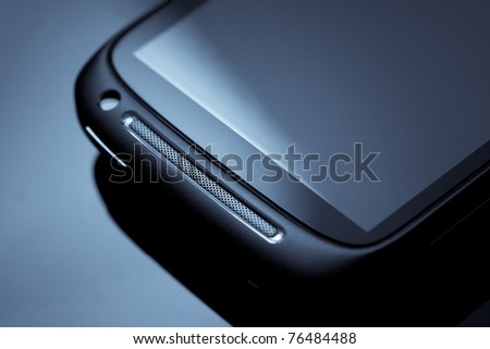Mobile phone, blue toned - stock photo
