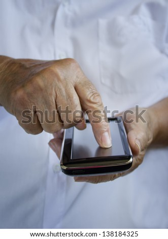 Mobile phone. Finger pointing on touch screen. - stock photo