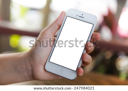Mobile phone in a woman's hand - stock photo