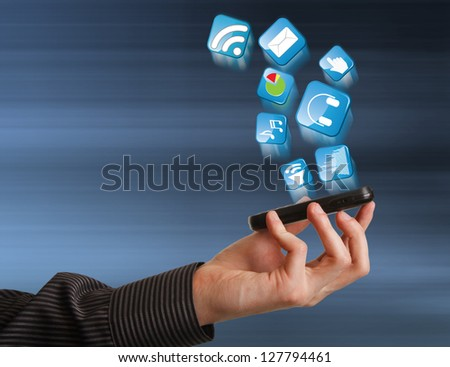 Mobile phone in hand businessman and Icons - stock photo
