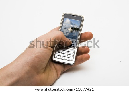 Mobile phone in hand, isolated
