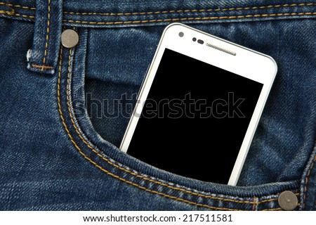 mobile phone in pocket with black screen. focus on screen.  - stock photo