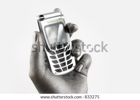 mobile phone in silver arm - stock photo