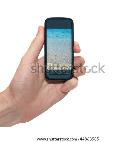Mobile phone in the hand with blue sea isolated on white