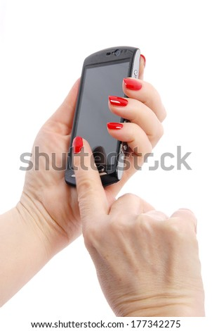 mobile phone in woman's hand with red nails