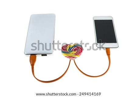 mobile phone loving a powerbank. - stock photo