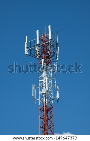 Mobile phone mast on blue sky background