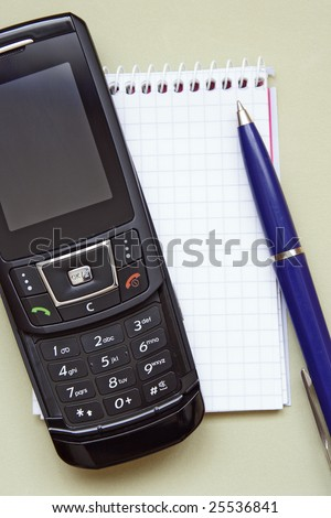 mobile phone,notepad and pen