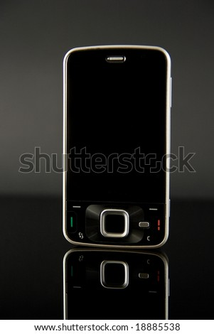 mobile phone on black glas - stock photo