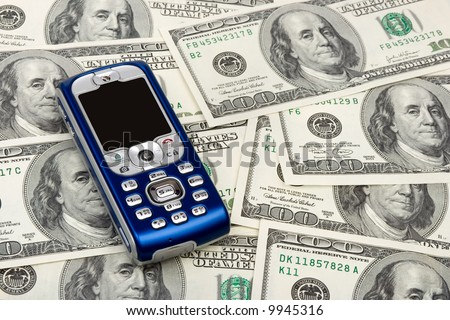 Mobile phone on money background, business concept - stock photo