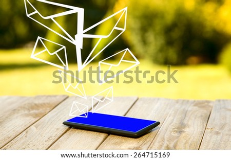 Mobile phone placed on wooden floor with nature background - stock photo