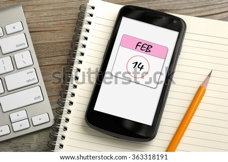 mobile phone showing Feb 14 calendar, Valentine's day  - stock photo
