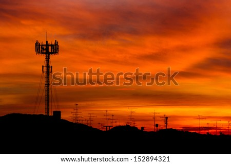 Mobile phone Telecommunication Radio antenna Tower. Cell phone tower with sunset sky, silhouette  - stock photo