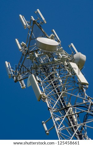Mobile phone tower with a blue sky - stock photo