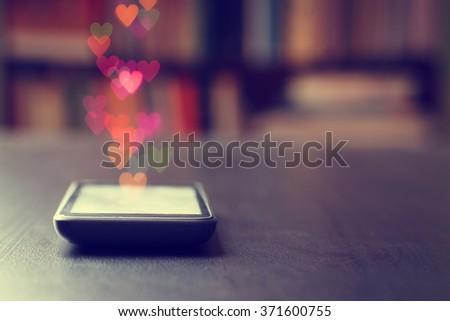 Mobile phone valentines closeup . - stock photo