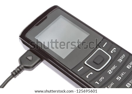 Mobile phone while charging. On a white background. - stock photo