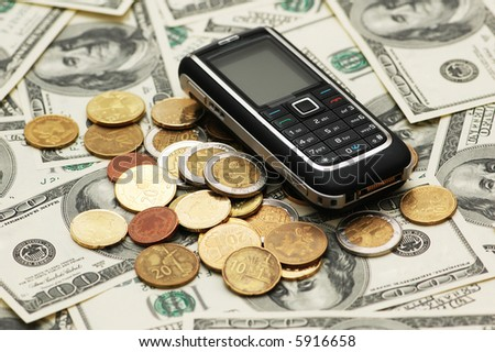 Mobile phone with coins  and dollar bank notes - more similar photos in my portfolio
