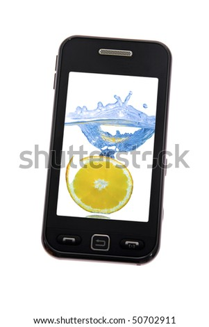 Mobile phone with lemon splash - stock photo