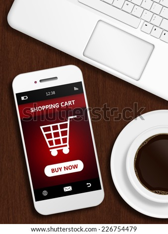 mobile phone with shopping card page, mug of coffee and laptop keybaord on wooden desk - stock photo