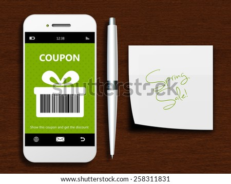 mobile phone with spring discount coupon and note lying on wooden table - stock photo