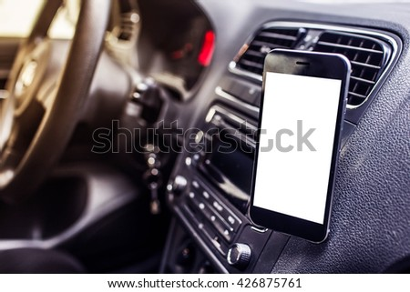 Mobile phones in the car - stock photo
