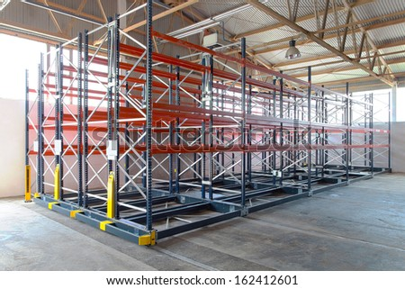 Mobile roller racking system in distribution warehouse - stock photo