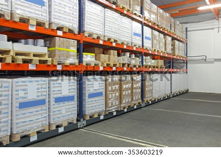 Mobile Roller Shelving System in Distribution Warehouse - stock photo