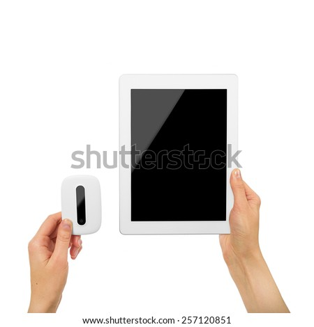 Mobile router with tablet pc in female hands. - stock photo