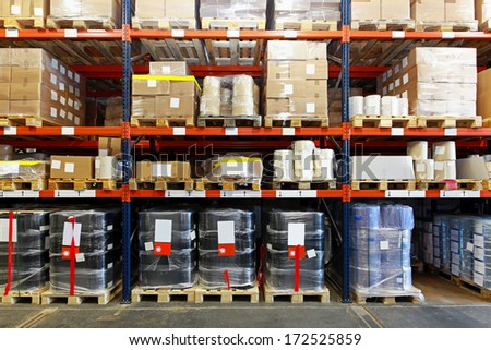 Mobile shelving system with goods in warehouse - stock photo