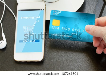 mobile shopping concept  - checking out in virtual shop - stock photo