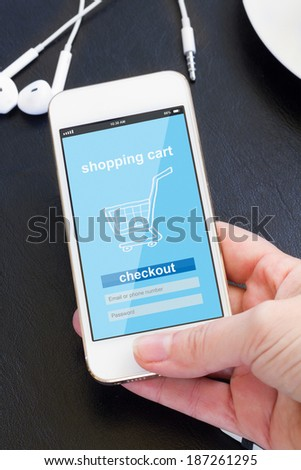 mobile shopping concept  - checking out in virtual shop on modern smat phone screen - stock photo