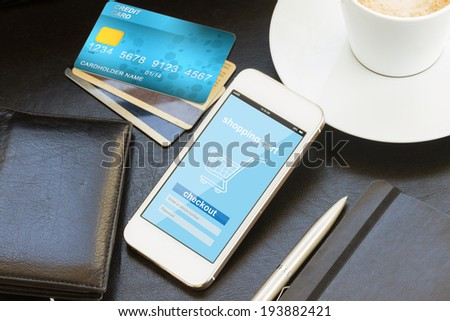 mobile shopping concept  -  virtual shop on phone screen with credit cards and wallet - stock photo