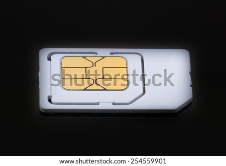 Mobile sim card on black floor background - stock photo